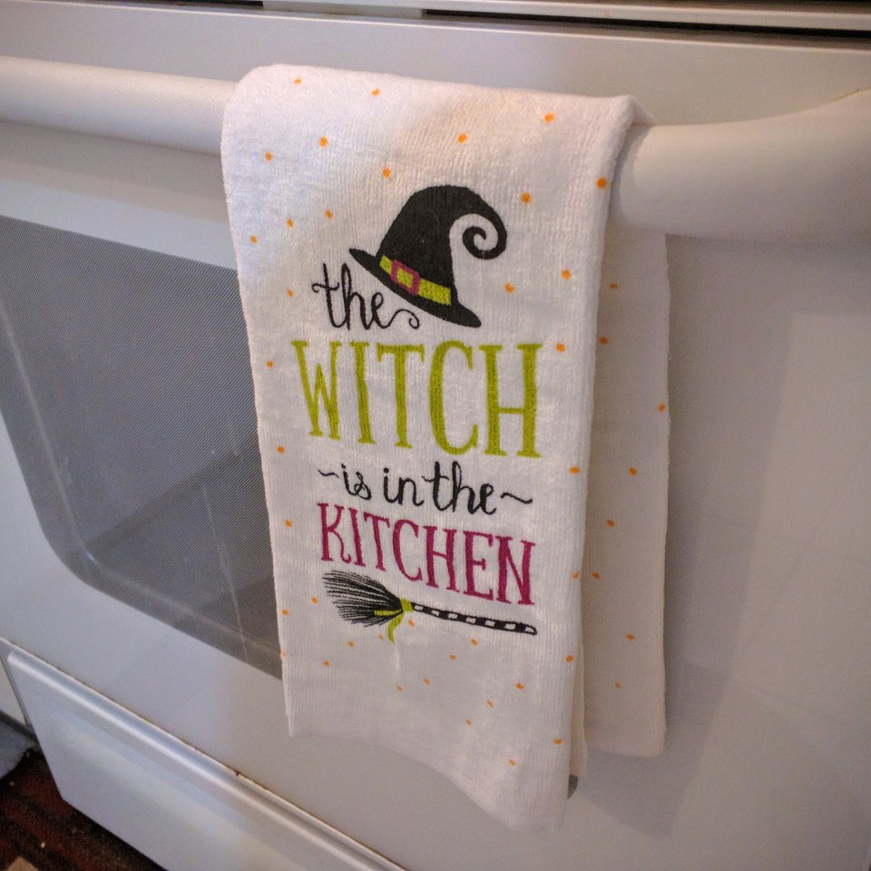 "Towel with the words ""The Witch is in the kitchen"""